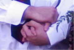 hands clasped at wedding